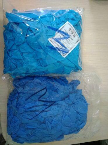 Нитриловые перчатки . Пр-Во Китай. В пластиковых упаковок