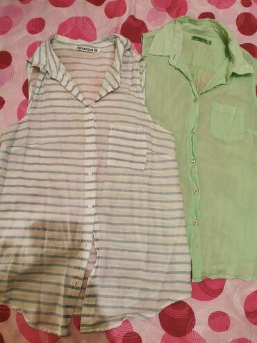 Dve Terranova košuljice, isti model, zelena S, bela XS. Obe za 500rs