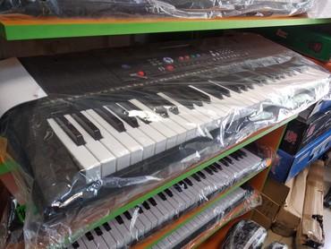 Pianino klavisi olan Sintezatorlar 5 oktava həcmində orginal pianino