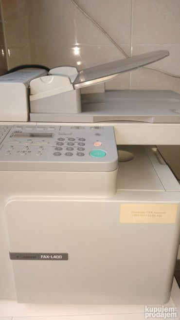 Prodajem fotokopir, štampač, faks, ispravan (zaglavio papir ne znam - Belgrade