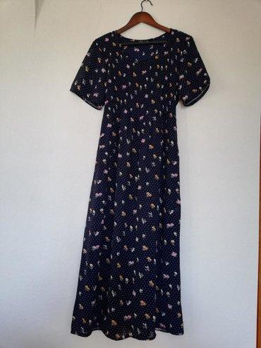 Haljine - Sremska Kamenica: Prodajem teget cvetnu haljinu, ne pise na njoj velicina ali mislim da