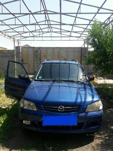Mazda Demio 1.5 л. 2002