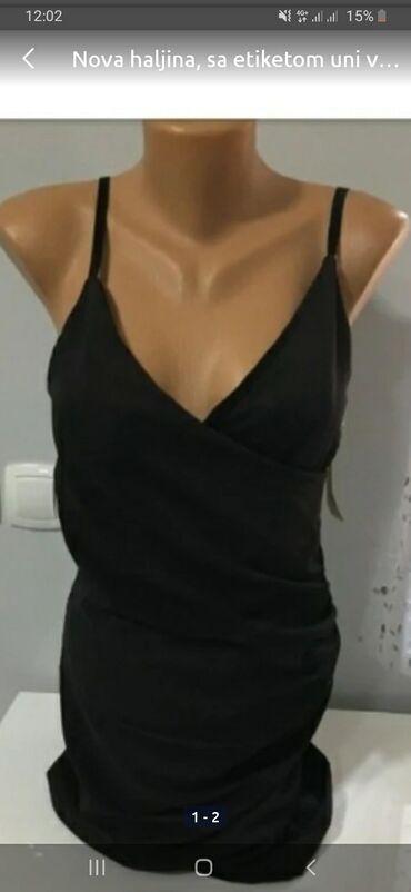 Nova haljina, sa etiketom uni vel.  srednje duga.iz Italije