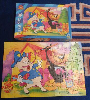 Puzzle - Srbija: Looney tunes Trefl puzzle- puzle. 100 komada. Lovac i patak Daca