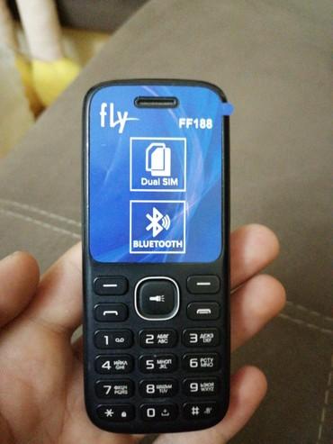 Fly ff188 Telefonun üzərində adaptor və karopka verilir в Хырдалан - фото 3