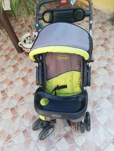 Oko stvari mix musko zenski prva klasa - Srbija: Kolica za bebe bertoniMenja se položaj rucke za vožnju u oba smera