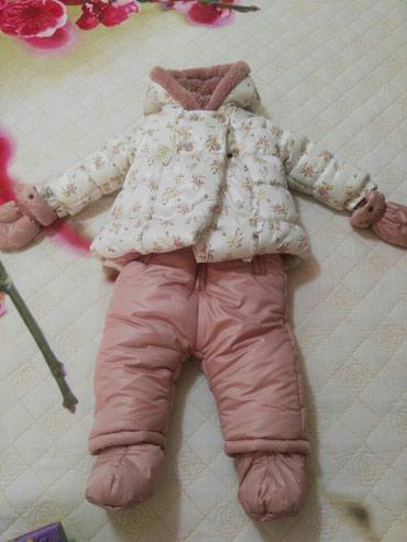 Продается новый комбинезон 2-ка на девочку,  9-12 мес. Очень теплый!!! в Бишкек