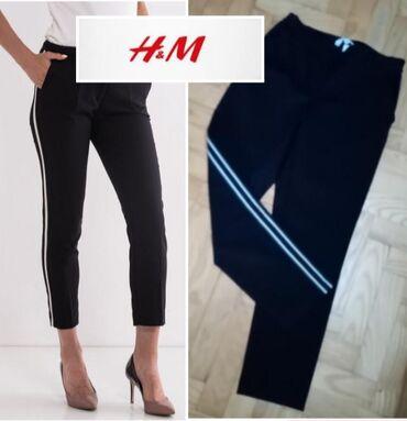 Pantalone flame moderno - Srbija: H M  Pantalone, moderne sa ukrasnom trakom sa bočne strane, nove su