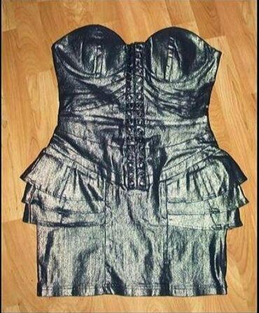 Ženska odeća | Senta: Peplum korset haljinaExtra,izvanredna `Bay` haljina, krut materijal-