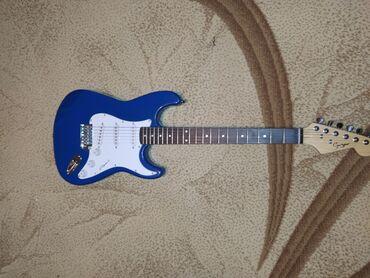 Elektro gitar Üst: Cökə ağacı Qol:Gül ağacı Ölçüsü 4/4  Yepyenidir, 1