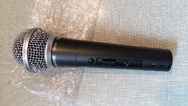 Микрофон модель SM 58 - это профессиональный динамический микрофон