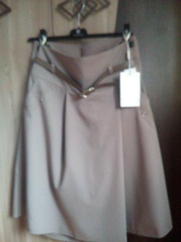 Gəncə şəhərində Продам юбка-шорты новая,цвет бежевый,36 размер,производство Турция,с