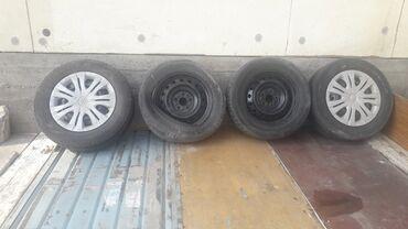 диски камри в Кыргызстан: Продаю диски в месте с шинами. На одном диске две трещины остальные