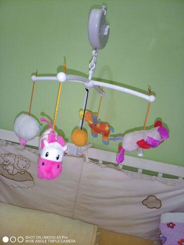 Tisza automotive - Srbija: Vrteška za bebu devojčicu na prodaju,na navijanje. svira,snimak rada