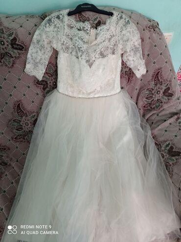 трикотажные платья дешево в Кыргызстан: Продам, дешево! Платье бежевого цвета, 44-46 размера, одевала только 1