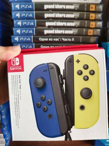 Nintendo Switch - Azərbaycan: Nintendo switch Joy con pultu. Tam bağlı upokovkada orginalÇatdırılma