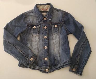 Куртка джинсовая на девочку 9-10 лет .В отличном состоянии