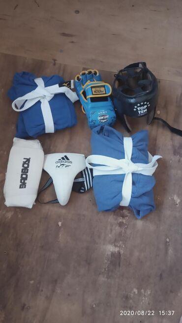 Спорт и хобби - Чон-Далы: Продаю Боксерский шлем кожаный-1500сомБандаж-500сомФуты-500сомКимоно
