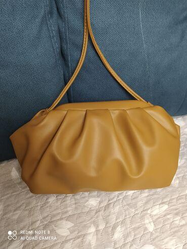 Очень милая,удобная,модная сумочка,отличного цвета,новая