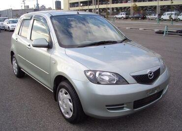 Mazda Demio 1.5 л. 2004