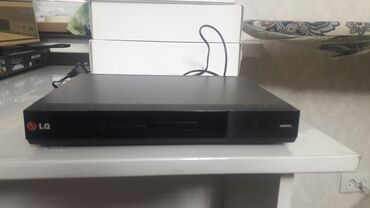 Компактный плеер DVD от LG модель DP132. Есть коробка и документы