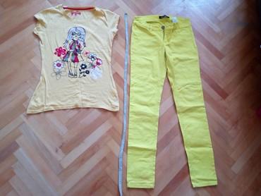 Ženska obuća | Nis: Majica Atmosphere i farmerice poklon.majica br.12,sirina 38