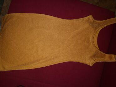 Pismo torbau oker boji na preklop dimenzije - Srbija: Haljinica uska uz telo u oker zlatnoj boji, velicina s-m, ima