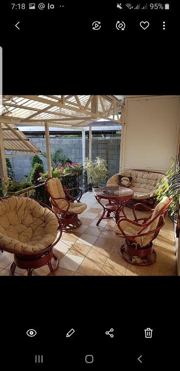 Великолепный садовый комплект из натурального ротанга станет прекрасны