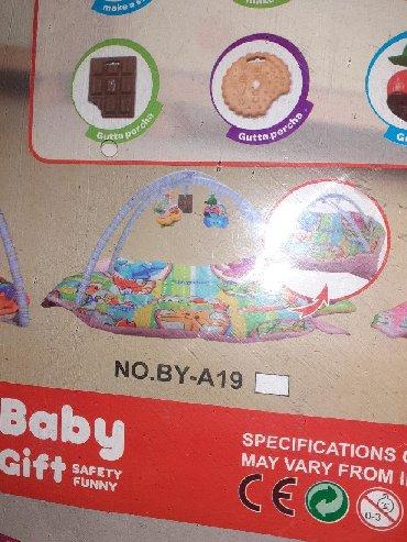 Lezaljka - Srbija: Lezaljka za bebukao nova u pakovanju. Iznad glave okace se igrackice