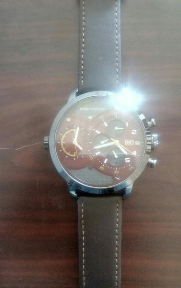 Mini Focus saat. MF; dual clock; dual watch, iki batareya gedir (böyük