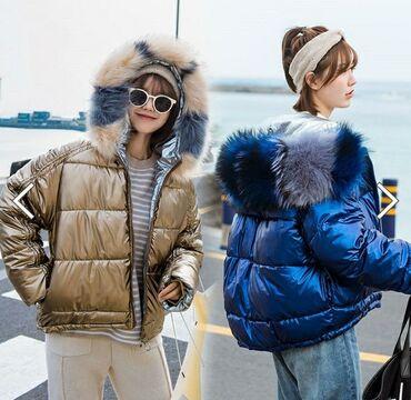 Продаю куртку зимную серебристого света производство гуанжоу