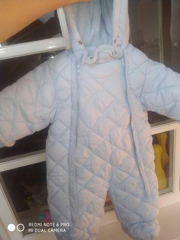 1. Комбинезон зимний голубого цвета,в абсолютно новом состоянии