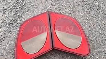 Mersedes w210 dörd gözün arxa kapotun üstündə olan stopları sağ sol