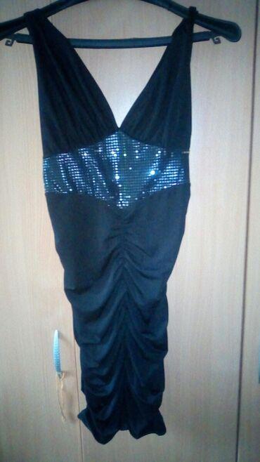 Strec s haljinica,crna. Bas se tegli pa mogu i XS i M da obuku. Za