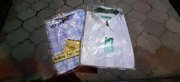 Рубашки новые размеры 42. Цена за обе 100сом