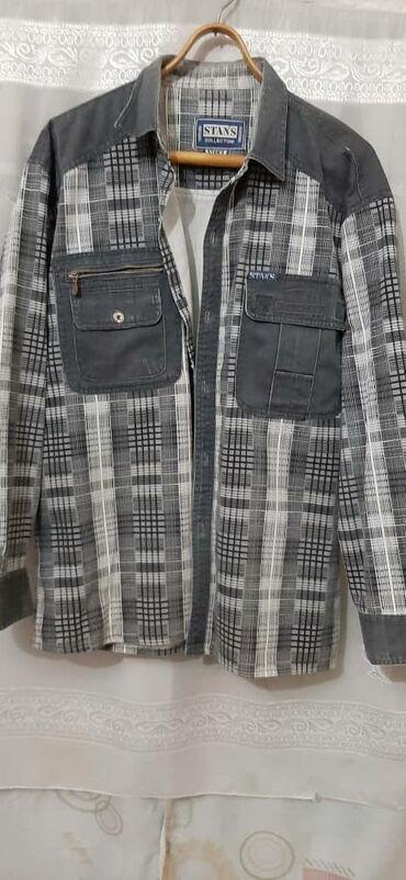 Мужская джинсовая рубашка,в хорошем состоянии. РАЗМЕР 50-52