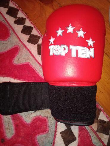 Спорт и хобби - Кочкор: Перчатки боксёрские12 унцовыеСостояние идеальноеПричина продажи