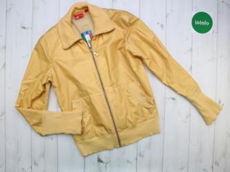 Куртка жіноча Puma, M    Бренд Puma  Розмір М Колір жовтий  Є сліди но