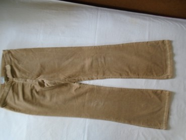 Pantalone zute - Srbija: Hepening pantalone zvoncare od baš uskog, nežno bež somota. Nošene su