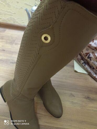 Кожаные сапоги,одевала пару раз, сильно жмут отдам за 1500с размер 38