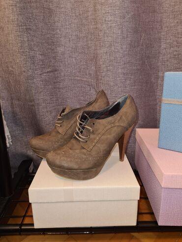Orginal suknjacine - Srbija: Krem cipele na pertluBroj 39Visina štikle 12 cmPlatforma 3 cmMalo su