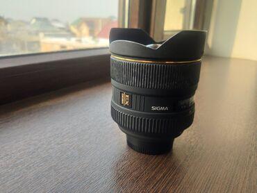 Фото и видеокамеры - Кыргызстан: Продаю объектив sigma 12-24mmсостояние хорошее. Объектив работает
