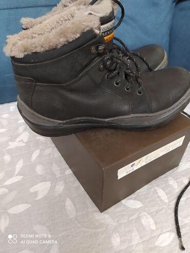 Зимние ботинки на цигейке в отличном состоянии,кожа,39размер.Турция.б/