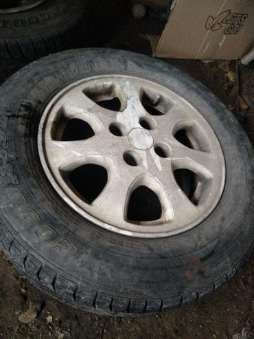Продаю шины с дисками 1 сезон отличное состояние 185 70 14 в Шопоков