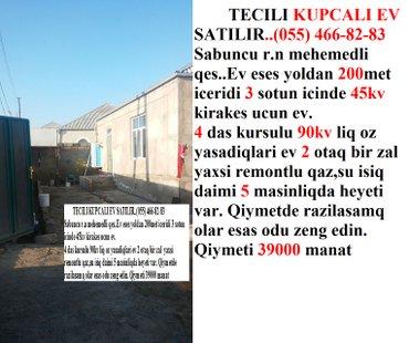 Bakı şəhərində Tecili kupcali ev satilir  ev eses yoldan 200met iceridi 3 sotun