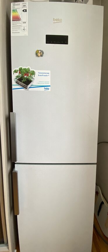 | Новый | Серебристый холодильник Beko