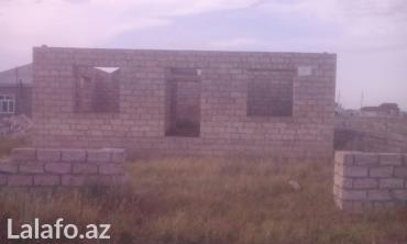 Недвижимость - Хачмаз: Xacmaz rayonunda bayraq meydaninin arxa terfinde 5 sot erazide yarim