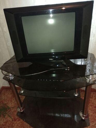 Продаю стол тумба стелянный под телевизор и телевизор за все 9500