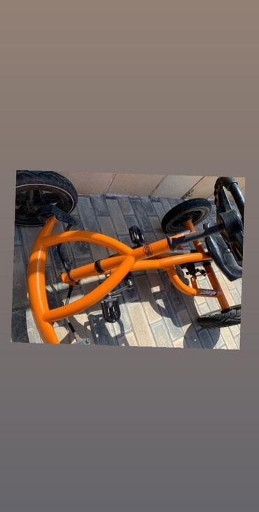 Parklarda surmek ucun masin velosiped. 3-10 yaş arasidir. Yaxsi