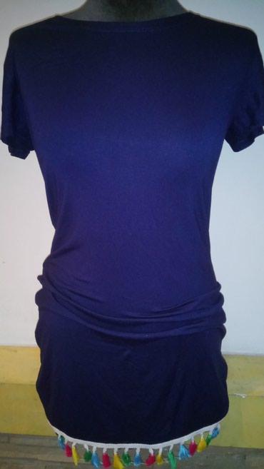 Pamucna haljina ravnog kroja. Ima kratak rukav I resice u dnu raznih - Novi Banovci